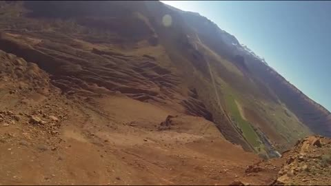BASE jumper flies away after scary cliff strike