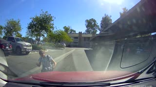 Skateboard guy sunglasses falls in front of red car driving dashcam