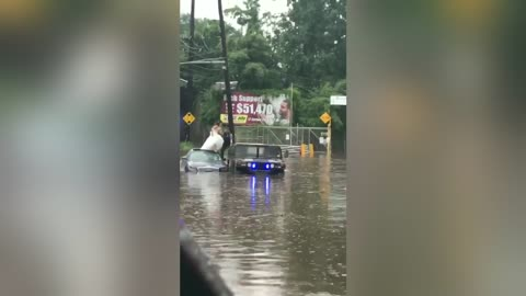 Officer Helps Bride To Get To Church Safely During Flood