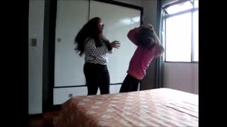 Girls dancing accidently headbutts - Video