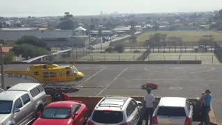 Helicopter fills up at school  - Video