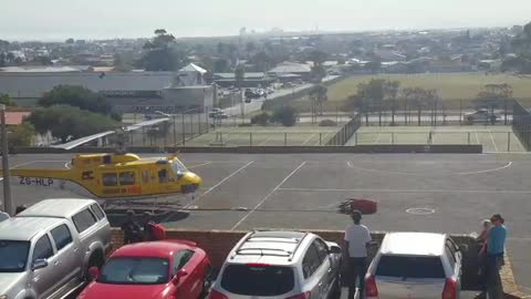 Helicopter fills up at school