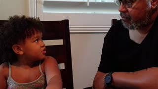 Little girl gives grandpa stern counseling