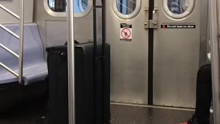 Man does tai chi in between subway cars - Video