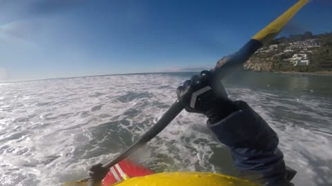Surfing ocean waves in a kayak!