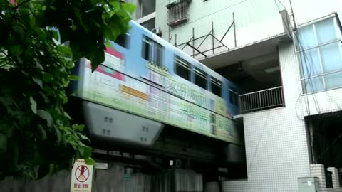 Disappearing Train Runs Through Block Of Flats In Crowded China