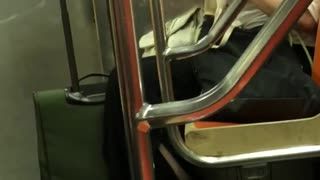 Woman goggles fixing bra on subway - Video