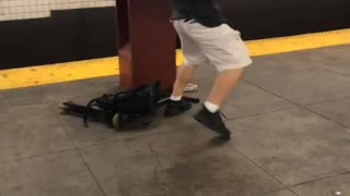Guy white shorts black shirt karate kick subway pole - Video