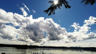 Time Lapse of clouds over Siltcoos Lake, Oregon.  - Video
