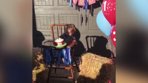 1 Year Old Boy Plays Flip Cup With Birthday Cake