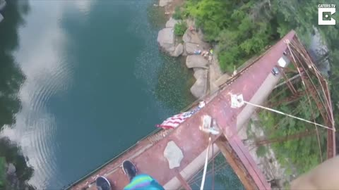 Thrill-Seeking Daredevil Jumps Off A Rickety Bridge Standing At 105ft