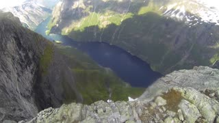 Dangerous wingsuit flying over stunning Norway
