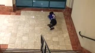 Man in blue jersey goes down stair rails falls - Video