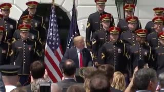 Heckler yells at President Trump during a White House event