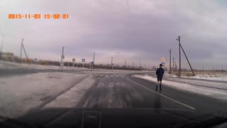 Man Skates on Black Ice Covered Road - Video