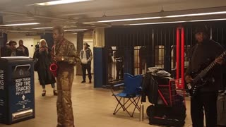 Musician Entertains Commuters With Saxophone Version Of 'Billie Jean' - Video