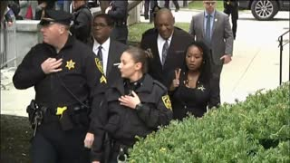 Topless woman protests as Bill Cosby arrives at courthouse - Video