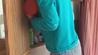 Girl hides her face after using her mother's makeup - Video