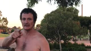 Shirtless Drunk Man Screams Racial Slurs at Park - Video