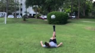 Guy tries to kick soccer ball but kicks ball into his own face - Video