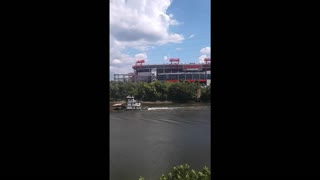 Tugboat Pushes Barge Down River