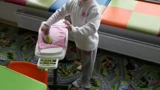 Little girl strokes linen