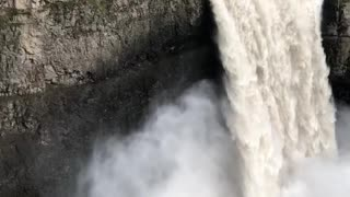 Melting Spring Snow Unleashes Powerful Waterfall