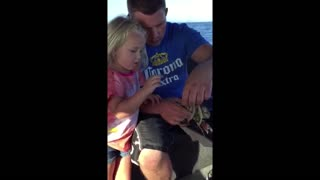 Dad's groin meets crab's pincers