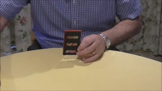 A Playing Card Escapes From An Impossible Situation  - Video