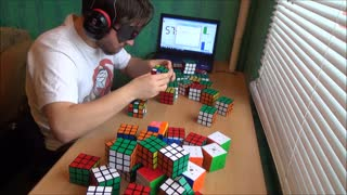 Solving 50 Rubik's Cubes blindfolded - Video