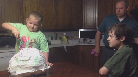 Girl tricked by balloon cake prank