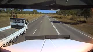 Small Truck Undertakes on Shoulder