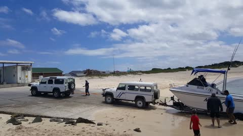 2 Land Rovers needed to pull boat out water