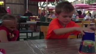 Kid Fails At Classic Cup Trick - Video