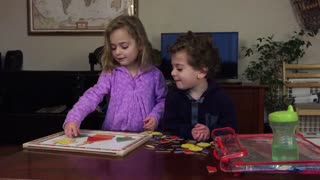Two Adorable Kids do Puzzle Together - Video