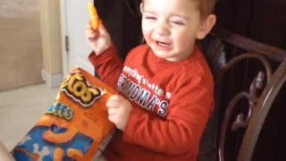 Eating Cheetos!