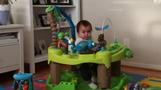 Playful child may have outgrown baby bouncer - Video