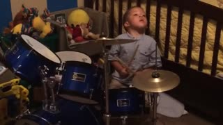 Talented toddler plays the drums adorably - Video