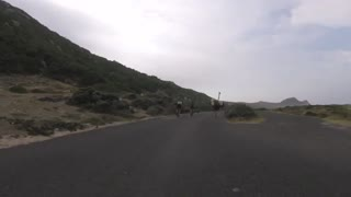 Cyclists chased by an ostrich in Africa - Video