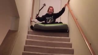 Two girls green air mattress stair slide - Video