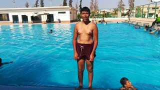 Funny Boy Performs Solid Strait Jumps At Swimming Pool