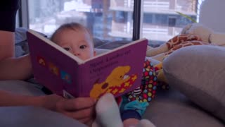 A small child reading a story
