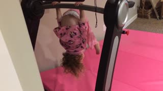 Little girl in pink upside falls on head - Video