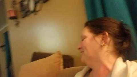 Toddler laughs hysterically at mom bugging her eyes out during kisses