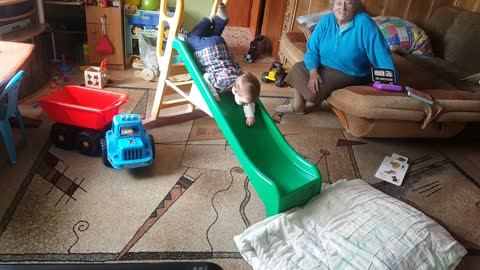 2 Years old Toddler finds his own way to use slide