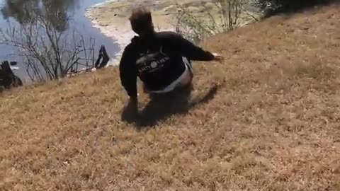 Guy attempts front flip lands on his head