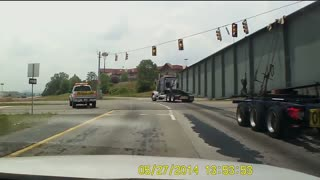 Truck Carrying Support Beam Tips Over on Highway - Video