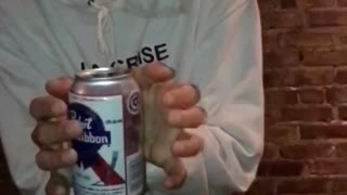 Guy in white la crise sweater does floating tricks with white beer can - Video