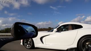 Two McLaren MP4-12C's battle a 2013 SRT Viper