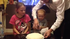 Toddler confused by gender reveal cake - Video
